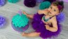 photo smash the cake petite fille tutu violet et gateau vert à Saint Victoret